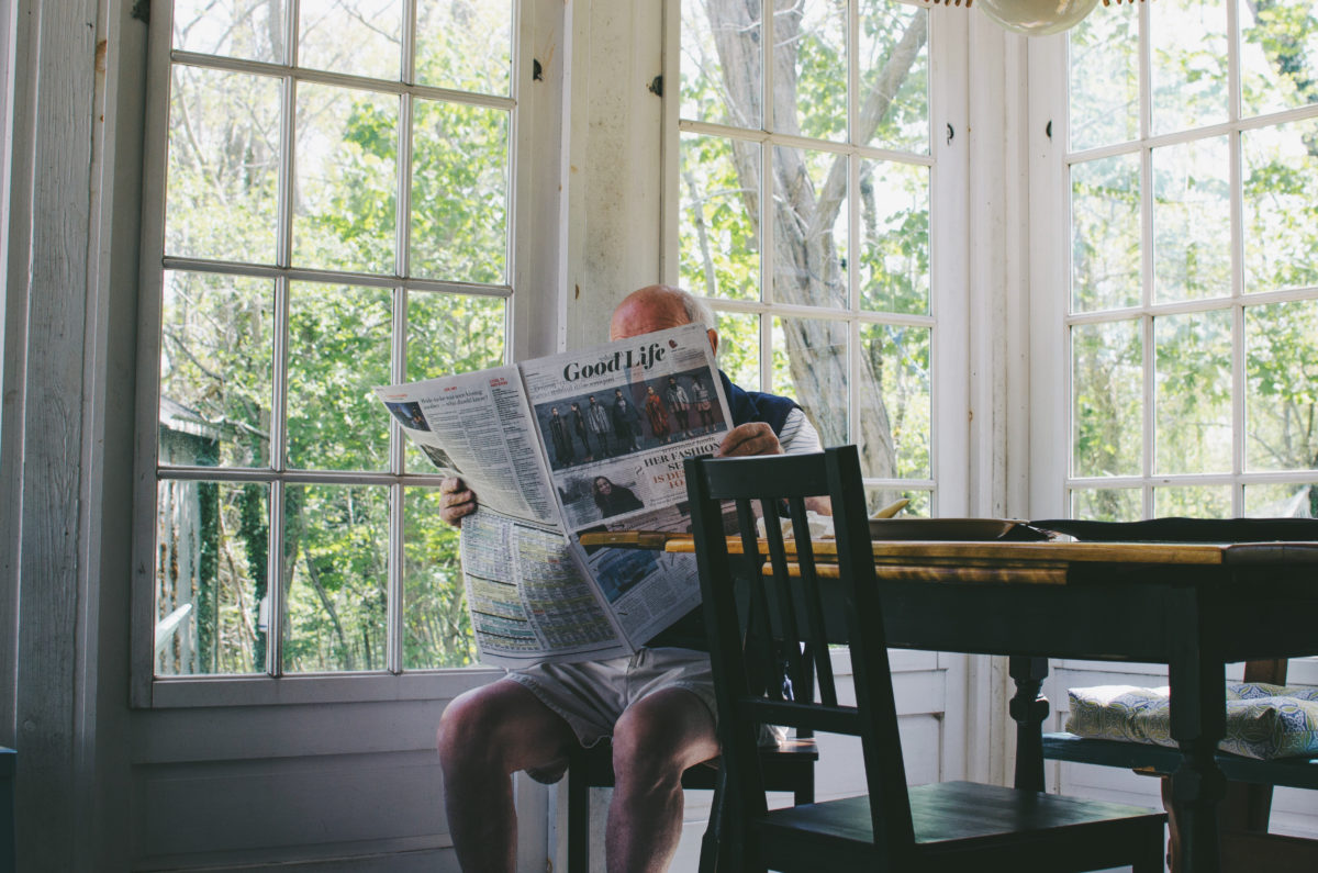 Man reading paper - how to deal with dementia denial